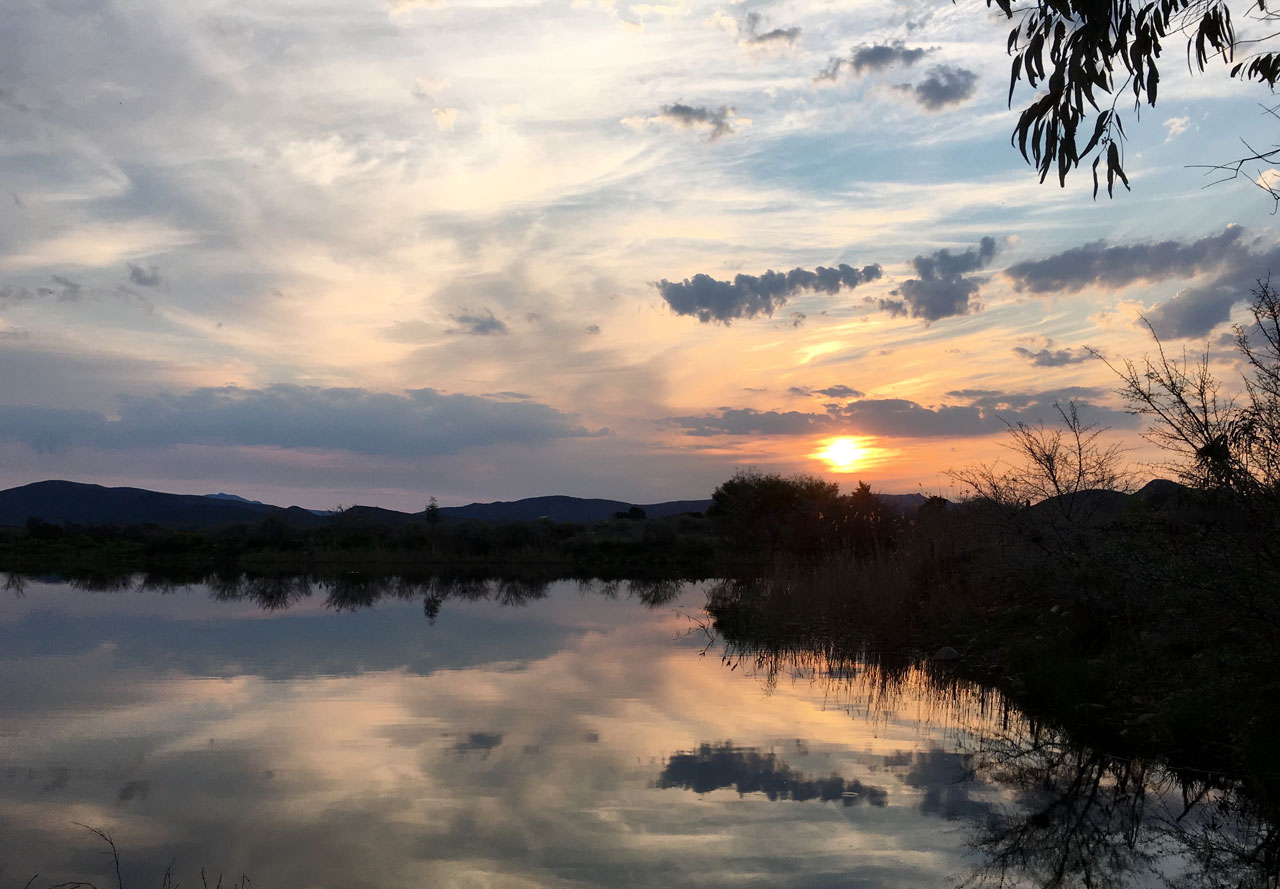 Sunset over the Riverton dam by Lara Barry